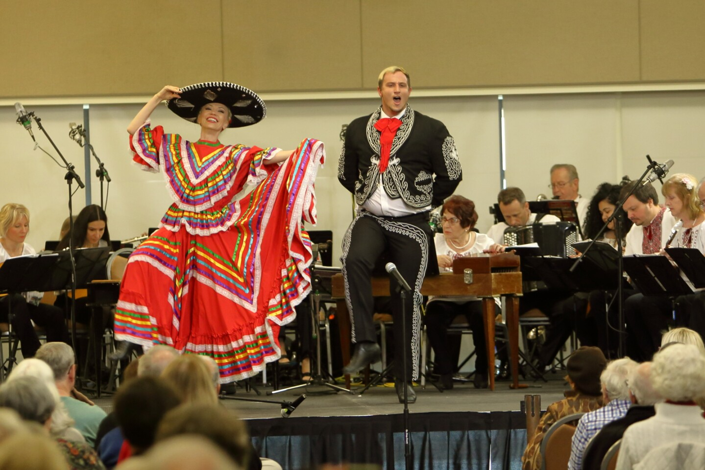The Los Angeles Balalaika Orchestra plays as Larissa Nazarenko and Tyler Worth dance to a traditional Mexican song