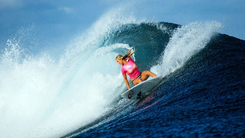 Bethany Hamilton, pictured surfing in Fiji in 2016, lost her left arm to a shark in 2003. She will be inducted into the Surfers' Hall of Fame on Friday in Huntington Beach.