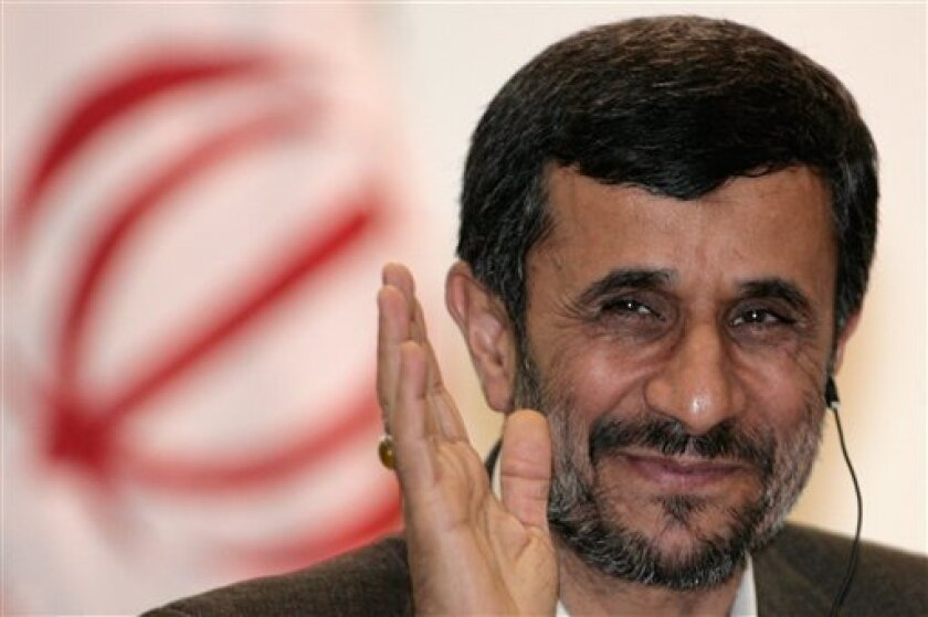 FILE - In this Nov. 23, 2009 file photo, Iran's President Mahmoud Ahmadinejad gestures during a news conference at the Itamaraty palace in Brasilia. The Iranian government approved a plan Sunday, Nov. 29, 2009 to build 10 industrial scale uranium enrichment facilities, a dramatic expansion of the program in defiance of U.N. demands it halt enrichment. The decision was made during a Cabinet meeting headed by President Mahmoud Ahmadinejad Sunday evening, according to Iran's state news agency IRNA. (AP Photo/Eraldo Peres, File)