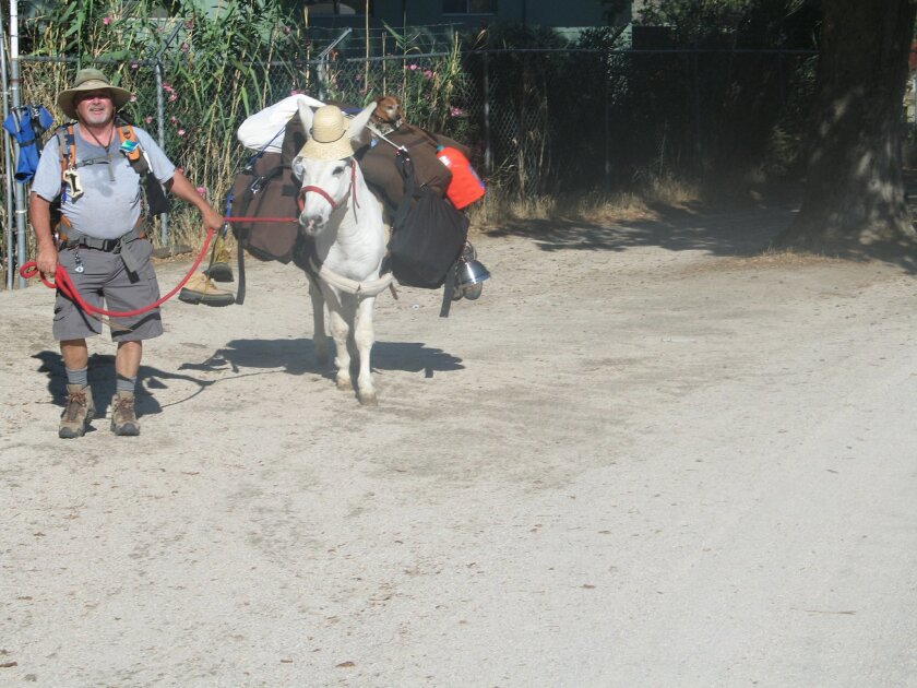 Mike Younghusband pictured here as he set out from Rancho Ojai on his trek to walk the length of Baja with his burro, Don-Kay, and two dogs.