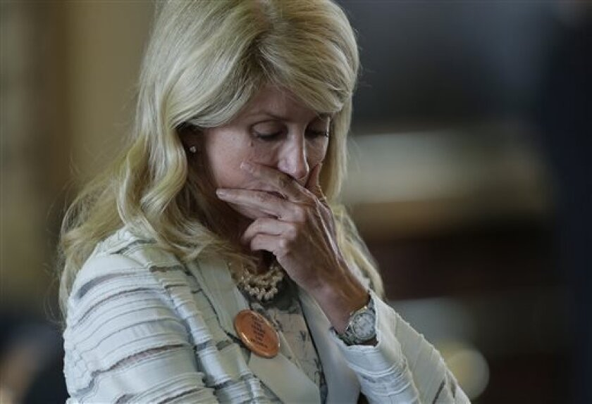 Sen. Wendy Davis, D-Fort Worth, reacts after she was called for a rules violation during her filibuster of an abortion bill, Tuesday, June 25, 2013, in Austin, Texas. Davis was given a second warning for breaking filibuster rules. (AP Photo/Eric Gay)