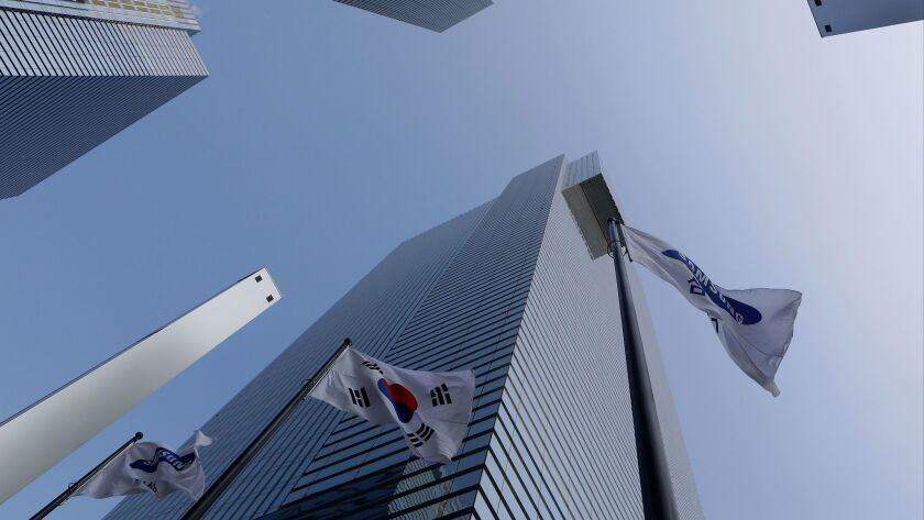 Flags fly outside Samsung headquarters in Seoul on Jan. 12.