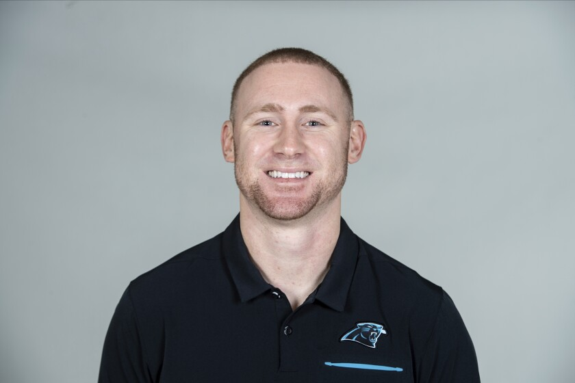 FILE - Joe Brady of the Carolina Panthers NFL football team is shown in a 2020 file photo. Panthers offensive coordinator Joe Brady is becoming a popular name for NFL teams seeking to fill head coaching vacancies. A person familiar with the situation says the Chargers, Falcons and Texans have all asked for and received permission from the Panthers to interview Brady for their head coaching jobs. (AP Photo/File)