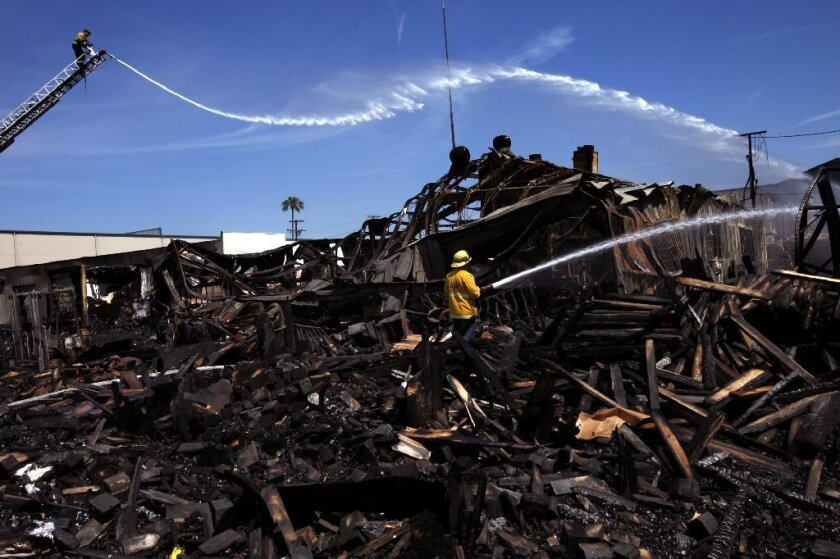 Firefighters hit hot spots after a major fire in North Hollywood