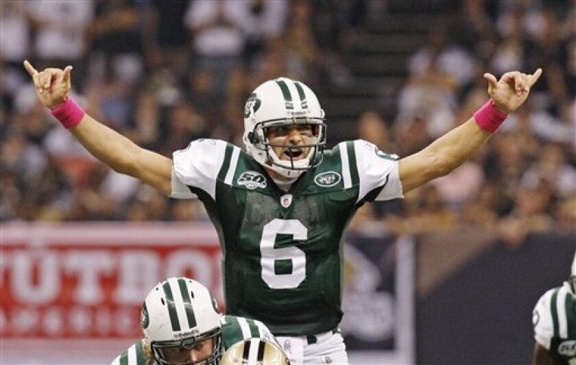 New York Jets quarterback Mark Sanchez (6) signals at the line of scrimmage against the New Orleans Saints in the first half of an NFL football game in New Orleans, Sunday, Oct. 4, 2009. (AP Photo/Bill Haber)