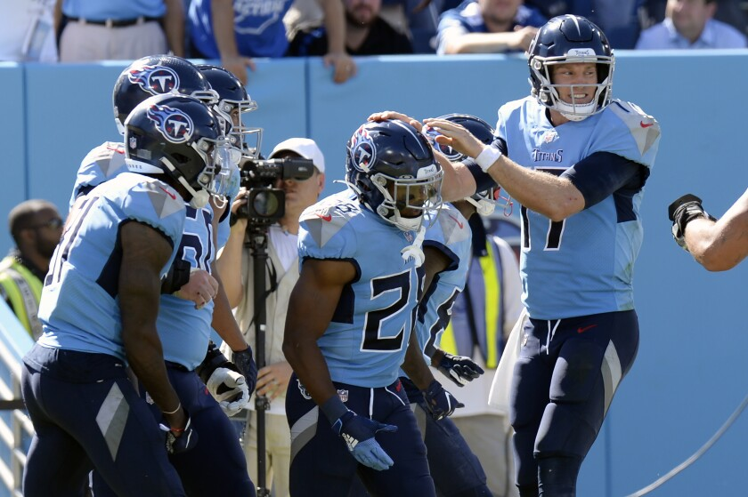 Tennessee Titans running back Jeremy McNichols (28) is congratulated by quarterback Ryan Tannehill (17) after they teamed up for a 10-yard touchdown pass against the Indianapolis Colts in the second half of an NFL football game Sunday, Sept. 26, 2021, in Nashville, Tenn. (AP Photo/Mark Zaleski)
