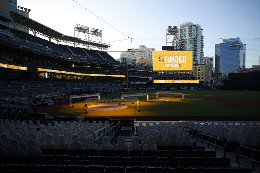Scoreboard tells the story after Padres clinched playoff berth Sunday at Petco Park.