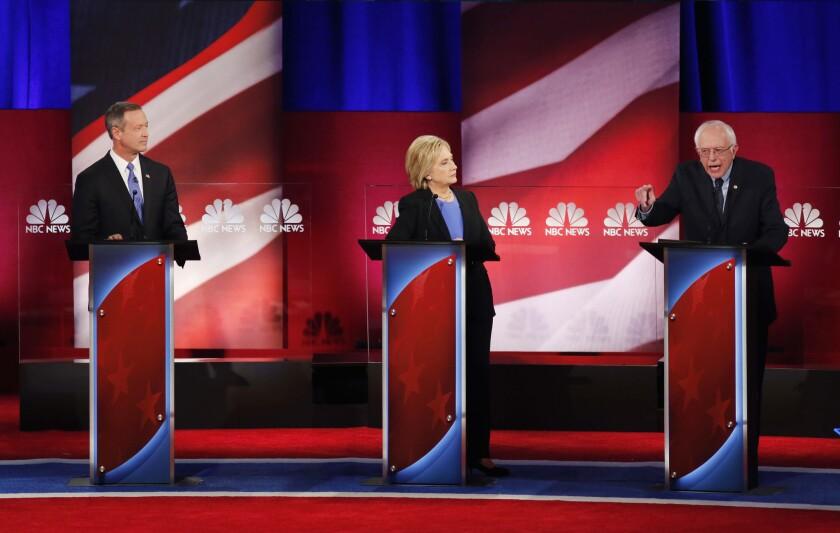 Democratic presidential candidates Martin O'Malley, left, Hillary Clinton and Bernie Sanders debate Sunday night at the Gaillard Center in Charleston, S.C.