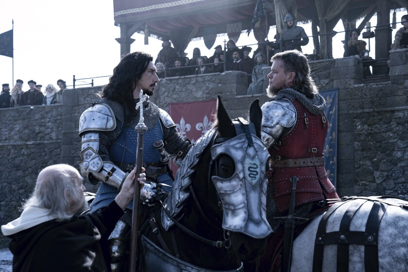 """This image released by 20th Century Studios shows Matt Damon as Jean de Carrouges, right, and Adam Driver as Jacques LeGris in a scene from """"The Last Duel."""" (Patrick Redmond/20th Century Studios via AP)"""