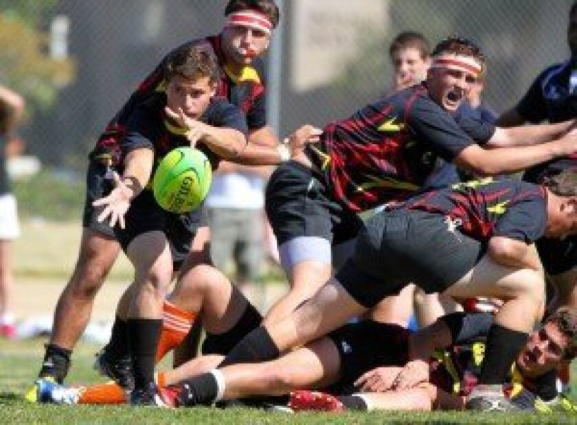 Mustangs U18 Scrum Half Dillon Loyek (pitching ball), and teammates Grant McGahey (top), Jacob Neeley (headband, yelling), Alec Barton (ground) and others are all focused on the High School National Invitational Championship in April. Photo: Susie Talman.