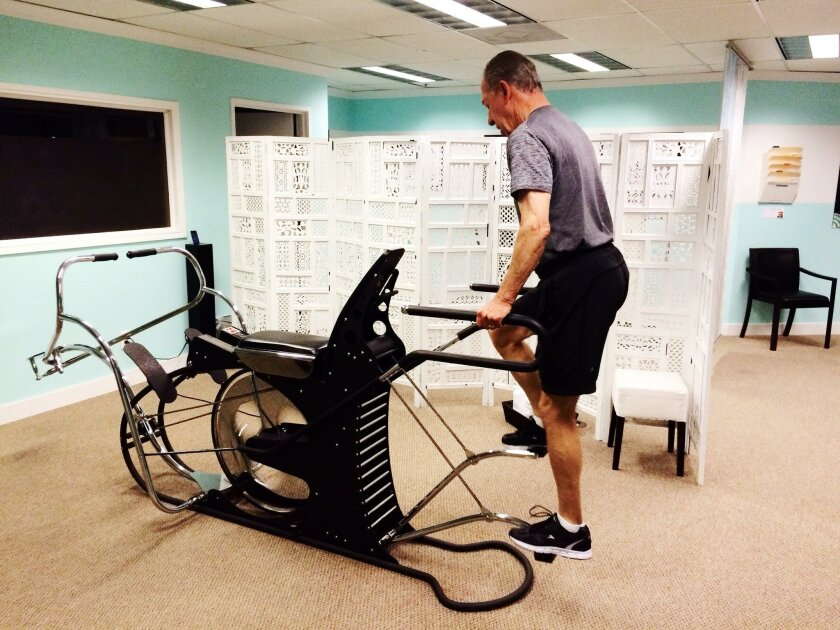 Phil Reed works out on the high-intensity Range of Motion (ROM) machine at La Jolla Wellness Studio, 7580 Fay Ave., Suite 103 in La Jolla. (858) 444-0340. lajollawellnessstudio.com