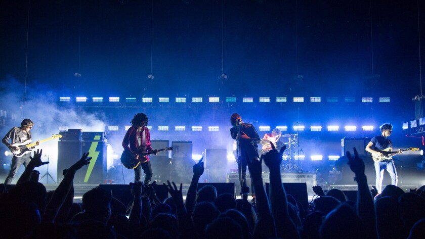 The Strokes perform at a benefit for a number of L.A. homeless charities on Monday evening.