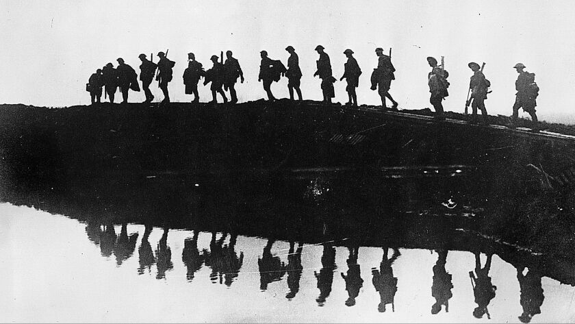 The end of World War I defined 1918, a centennial that will be marked around the world. This vintage photo shows supporting troops of the 1st Australian Division in Belgium.