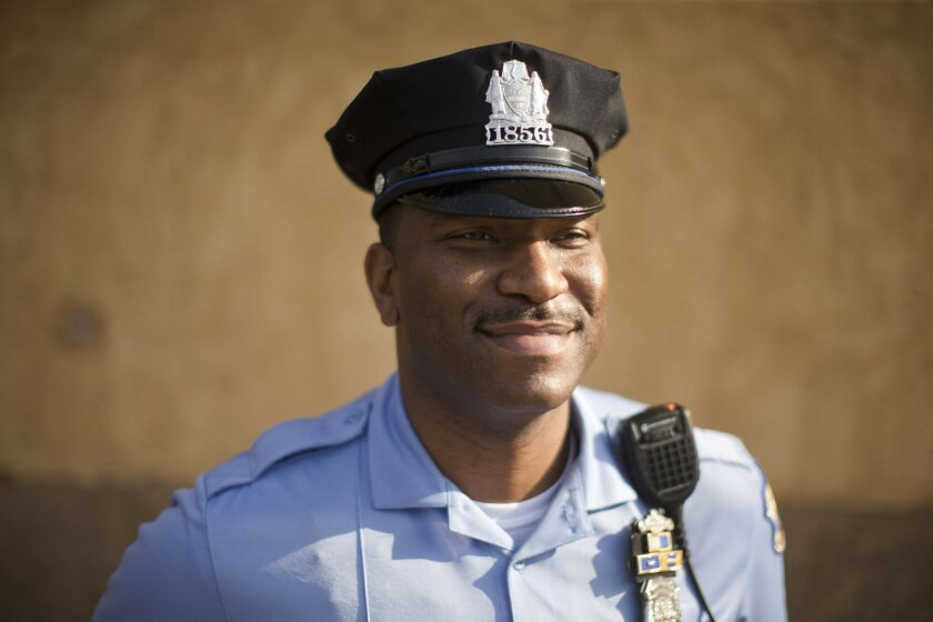 Philadelphia police Officer Eric Tyler poses for a photograph, Thursday, May 26, 2016, in Philadelphia. Tyler was recognized for using a stun gun instead of a real gun on a suspect who threatened to shoot his colleague in February. Tyler, who has never shot anyone in his 12-year career, said he con