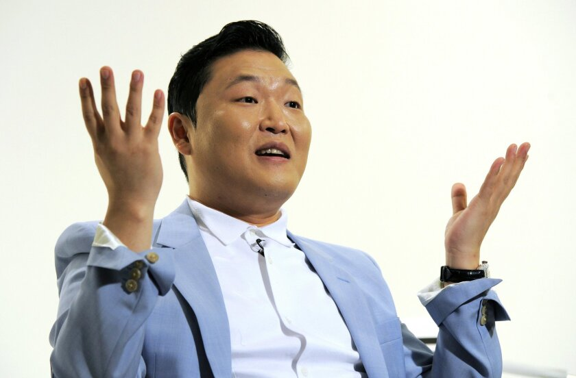 """In this Wednesday, June 4, 2014 photo, South Korean musical performer Psy speaks during an interview in Los Angeles. The ubiquitous 2012 hit is one Psy knows he probably will never top, and that makes creating new music quite a challenge. """"People always comparing my new thing with 'Gangnam Style,' which is unbeatable,"""" said Psy in a recent interview at YouTube Space LA. (Photo by Chris Pizzello/Invision/AP)"""