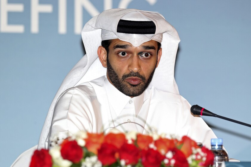 FILE - In this Thursday, Feb 25, 2015 file photo, Hassan Al Thawadi, head of the Qatar 2022 World Cup organizing committee he speaks during a press conference, in Doha. Organizers of the World Cup in Qatar are concerned that many fans won't be able to afford traveling to the tournament in 2022 if the coronavirus pandemic causes a global recession. (AP Photo/Osama Faisal, File)