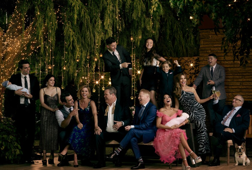 "This image released by ABC shows the cast of the ABC sitcom ""Modern Family,"" from left, Reid Ewing, Ariel Winter, Ty Burrell Julie Bowen, Eric Stonestreet, Nolan Gould, standing left, Jesse Tyler Ferguson, Aubrey Anderson-Emmons, standing center right, Jeremy Maguire, Sarah Hyland, seated, Sofía Vergara, Rico Rodriguez and Ed O'Neill. The comedy will air its series finale after 11 seasons on April 8, the network announced on Wednesday. (Jill Greenberg/ABC via AP)"