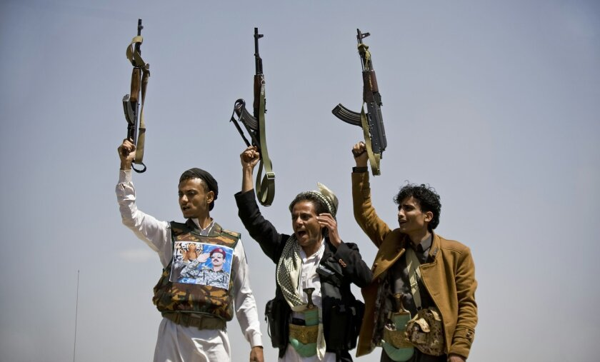 Supporters of Ahmed Ali Abdullah Saleh, the son of Yemeni former President Ali Abdullah Saleh, hold their weapons as they chant slogans during a demonstration demanding presidential elections be held and the younger Saleh run for the office, in Sanaa, Yemen, Tuesday, March 10, 2015. (AP Photo/Hani