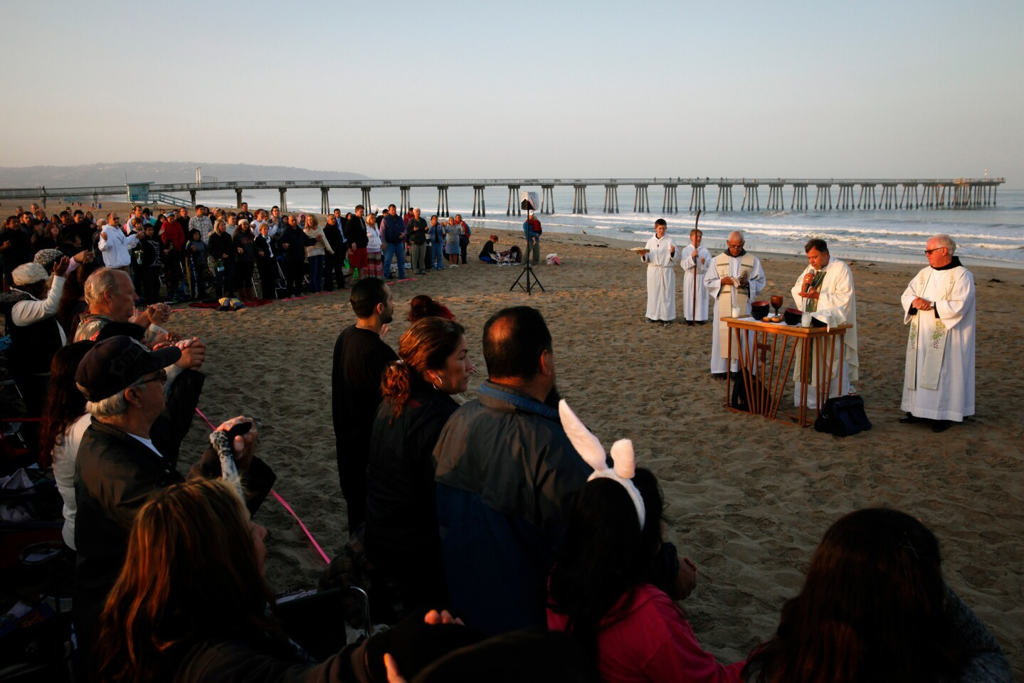 The congregation of Our Lady of Guadalupe Hermosa Beach Catholic Church celebrates Easter Sunday Mass.