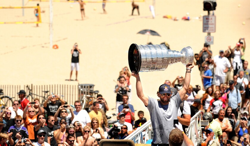 Kings center Jarret Stoll raises the Stanley Cup along the strand in Hermosa Beach during a victory celebration.