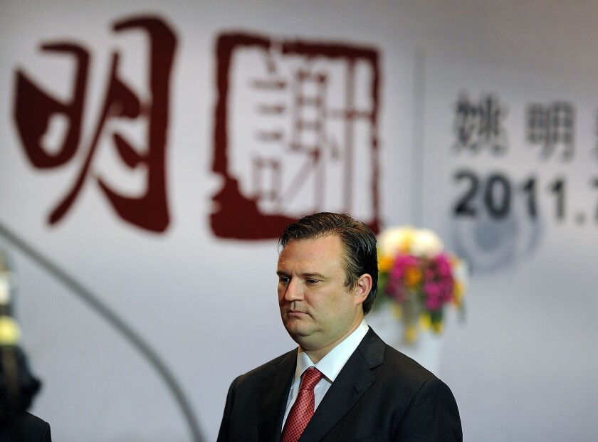 Houston Rockets general manager Daryl Morey attends Yao Ming's retirement news conference in China in 2011.