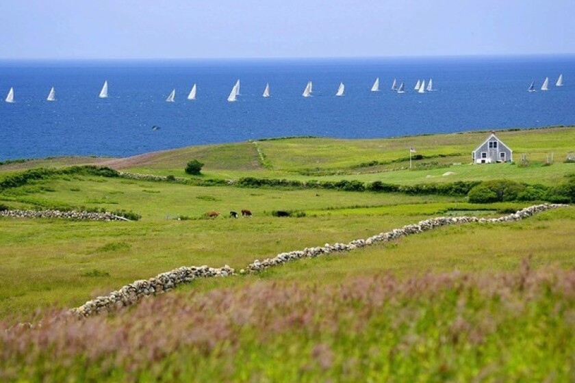 Looking across the Lewis Farm at sailboats on the Atlantic. Block Island is 13 miles off the Rhode Island coast and 14 miles from the eastern tip of Long Island. The island is less than 11 square miles and can be explored on foot or rented bicycle.