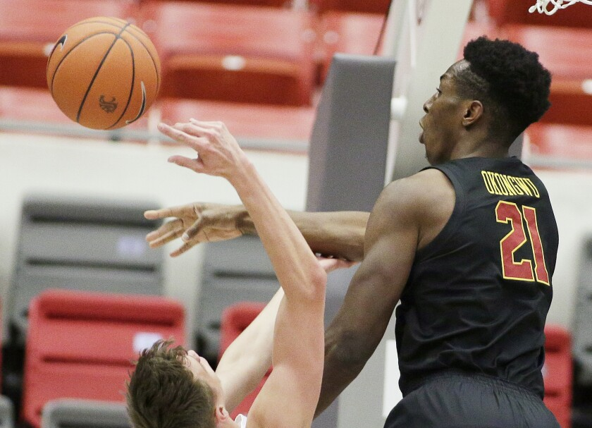 USC forward Onyeka Okongwu, right, blocks a shot by Washington State forward Aljaz Kunc.