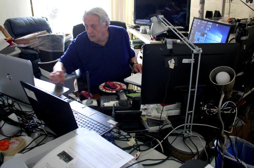 John Ellison in his man cave at Casa de Mañana. Here, the 85-year-old former electronics engineer Skypes with family and friends, reads online aeronautical journals and monitors global economic trends.