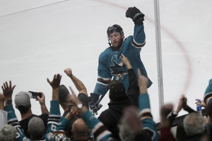 San Jose Sharks right wing Stefan Noesen celebrates with fans after scoring a goal against the Toronto Maple Leafs during the third period of an NHL hockey game in San Jose, Calif., Tuesday, March 3, 2020. (AP Photo/Jeff Chiu)