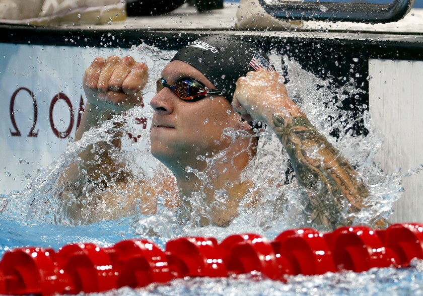 Caeleb Dressel celebrates after winning the men's 50-meter freestyle at the Tokyo Olympics on Sunday.