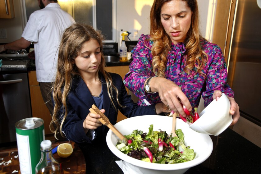 Fleur Perry Lang and daughter Noa prepare a French salad.