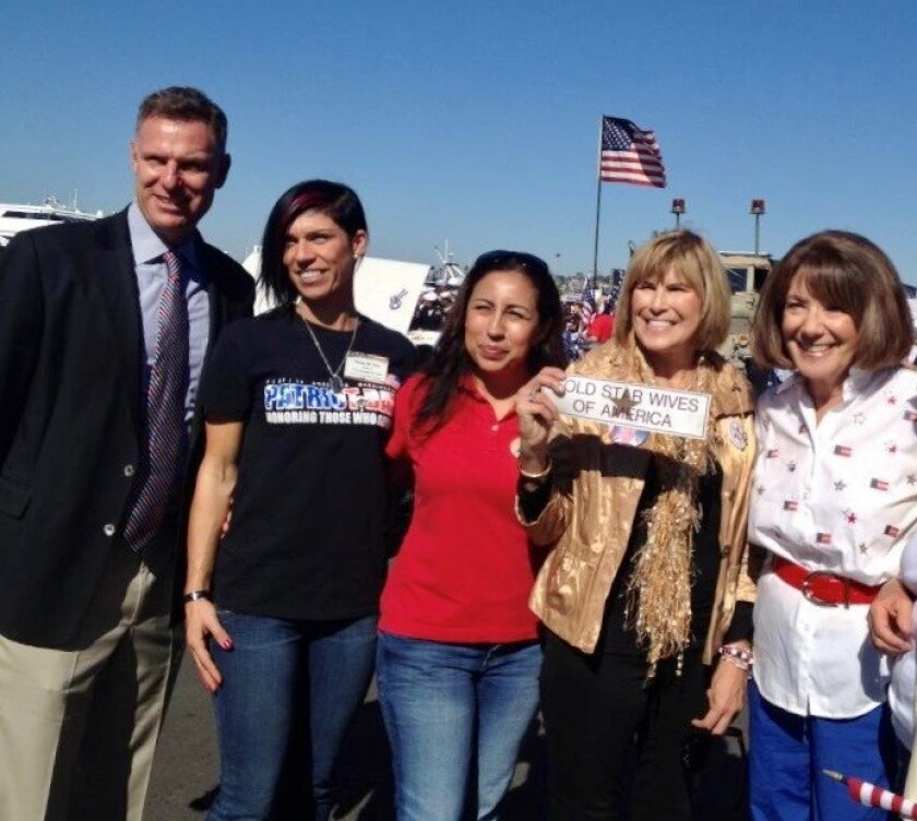 Kathy Soliozy Prout with Gold Star Wives sign with Scott Peters and Susan Davis at Vets Parade.jpg