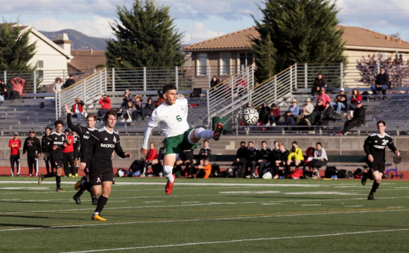 ONE TIME USE - Angel Amezcua of Alisal High School jumps for the ball in a game against Bella Vista