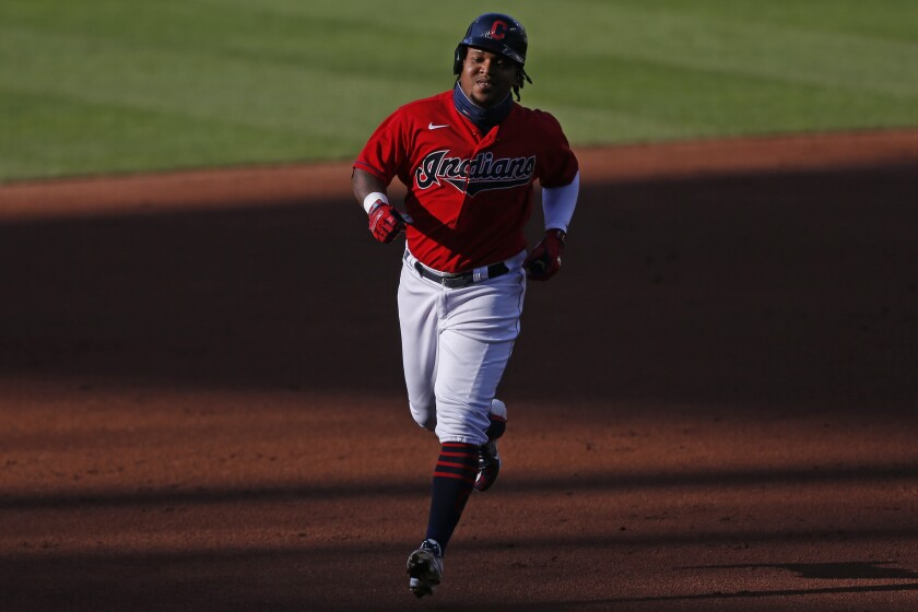 Cleveland Indians' Jose Ramirez runs the bases after hitting a solo home run off Cincinnati Reds starting pitcher Luis Castillo during the first inning of a baseball game at Progressive Field, Thursday, Aug. 6, 2020, in Cleveland. (AP Photo/David Dermer)