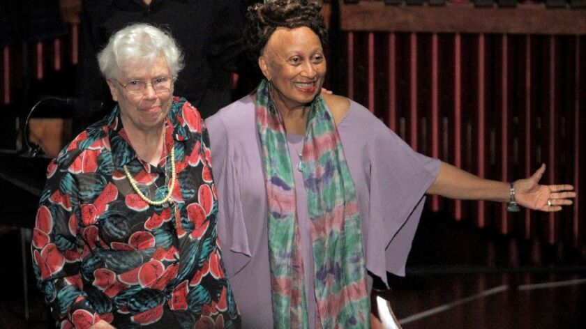 "Composer Pauline Oliveros (left) and librettist Carol Ione acknowledge the first performance of their 2013 opera, ""The Nubian Word for Flowers,"" in Los Angeles. Oliveros died Thursday at the age of 84."