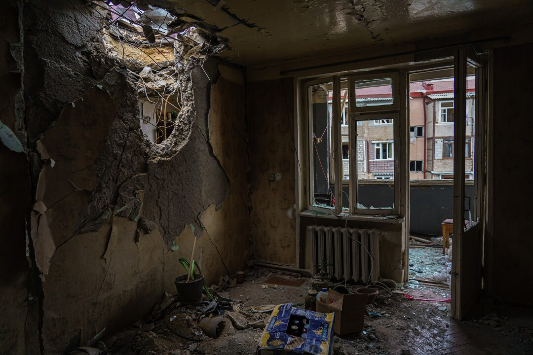 A view inside the living room where a gun pierced the ceiling of a residential building.