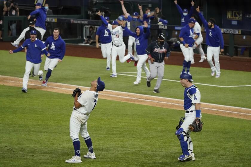 Los Angeles Dodgers pitcher Julio Urias celebrates their win.