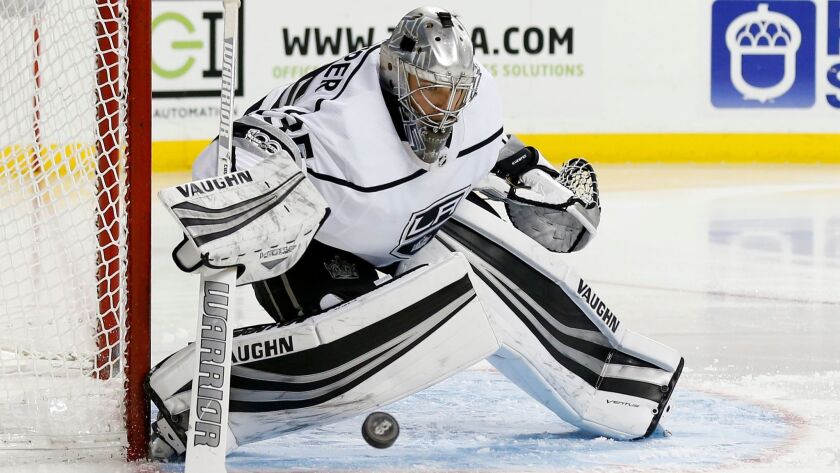 Los Angeles Kings goalie Darcy Kuemper is shown making a save against the New York Islanders on Dec. 16, which is the last time he played.