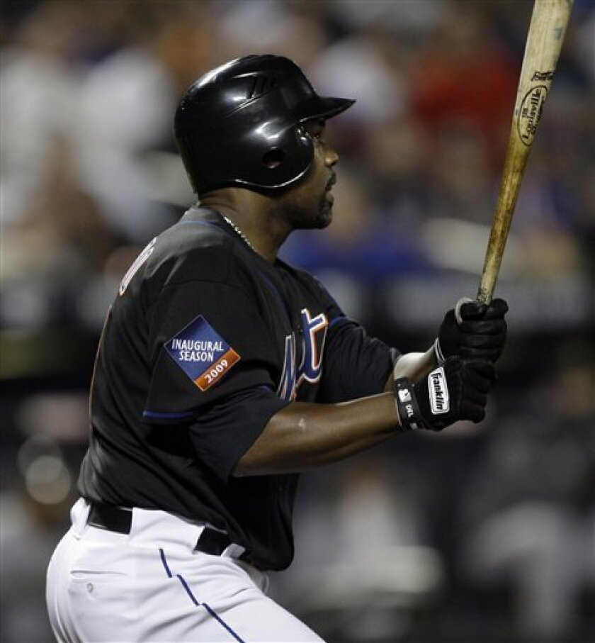 New York Mets' Carlos Delgado watches his eighth inning three-run home run sail over the right field wall against the Pittsburgh Pirates during a baseball game Friday, May 8, 2009 at Citi Field in New York. (AP Photo/Julie Jacobson)