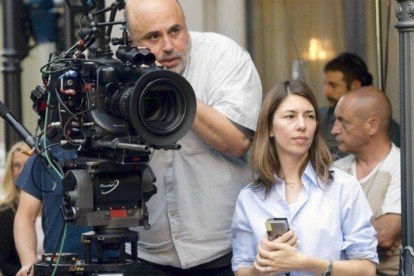 "Harris Savides and director Sofia Coppola work on the set of ""Somewhere."""