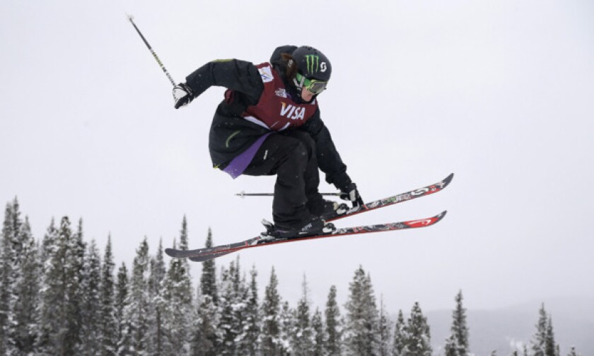 U.S. Olympian Keri Herman grabs a ski while performing a jump during a World Cup slopestyle freestyle skiing event in Colorado on Dec. 21. Herman's passion for the new Olympic sport was preceded by a love for hockey.