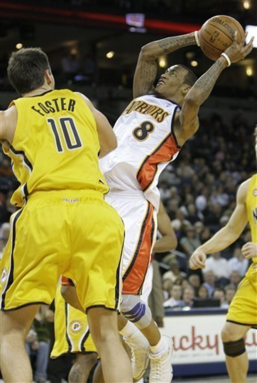 Golden State Warriors guard Monta Ellis (8) shoots against Indiana Pacers center Jeff Foster (10) in the second quarter of an NBA basketball game in Oakland, Calif., Monday, Nov. 30, 2009. (AP Photo/Jeff Chiu)