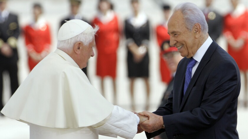 Peres, then Israeli president, welcomes Pope Benedict XVI to Israel on May 11, 2009.