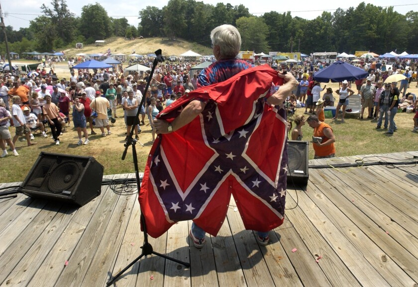 A performer wears a confederate flag overcoat at the Summer Redneck Games in July 2006 in Dublin, Ga.