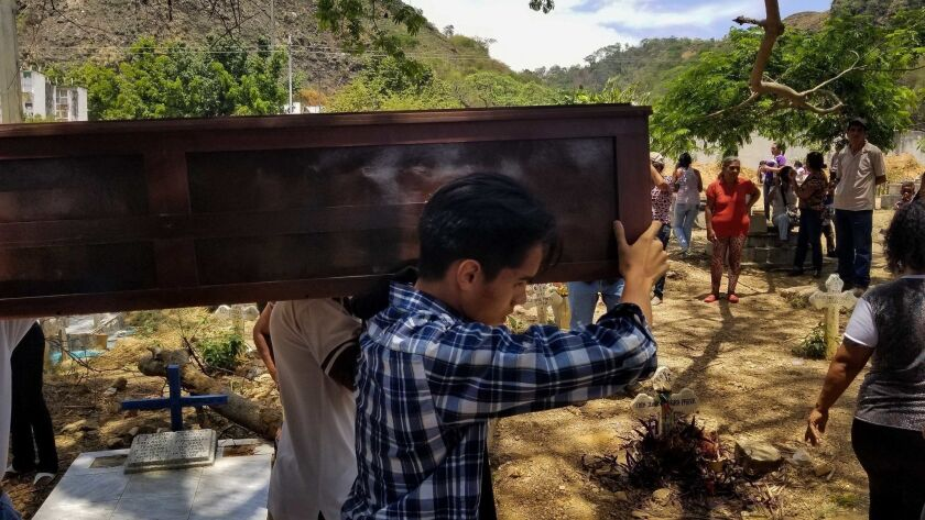 Burial of prisoners deceased in the fire of the General Command of the Carabobo Police, Valencia, Venezuela - 30 Mar 2018