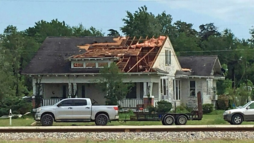 A roof is torn off a home following a suspected tornado, Saturday, April 13, 2019 in Franklin, Texas