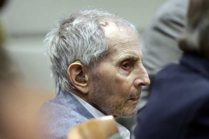 FILE - In this Tuesday, March 10, 2020, file photo, real estate heir Robert Durst listens to his defense attorney give their opening statement during his murder trial in Los Angeles. Durst's trail has been delayed for three weeks over fears of the transmission of coronavirus and will stand adjourned until April 6. (AP Photo/Alex Gallardo, Pool, File)