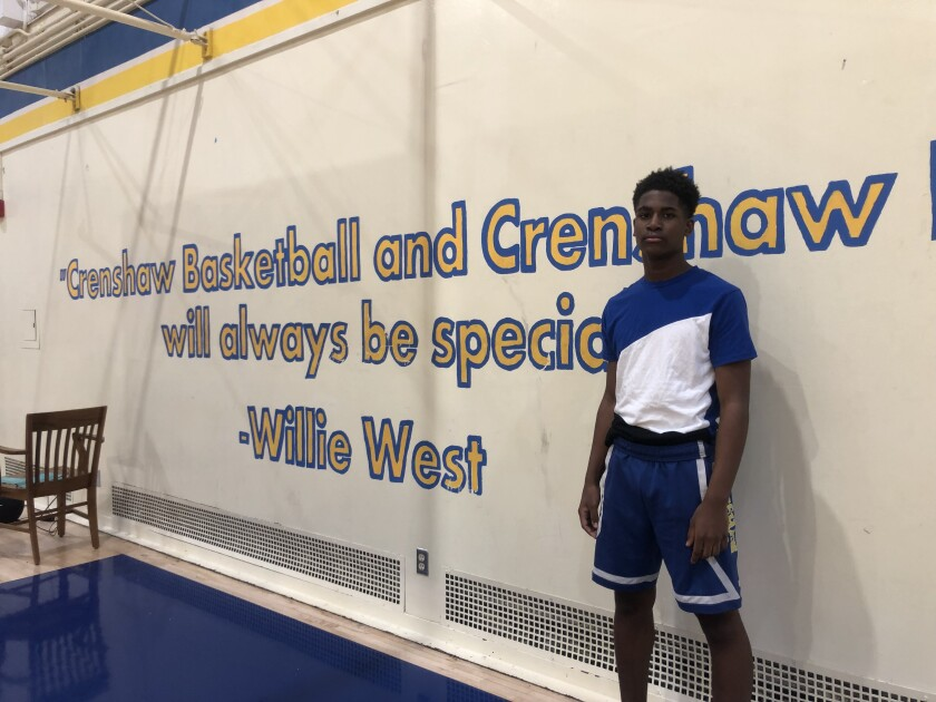 Crenshaw point guard KJ Bradley poses for a photo.