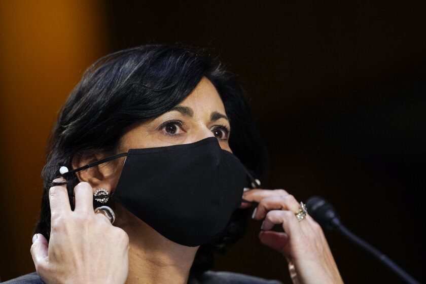 Dr. Rochelle Walensky adjusts her face mask during a Senate hearing.