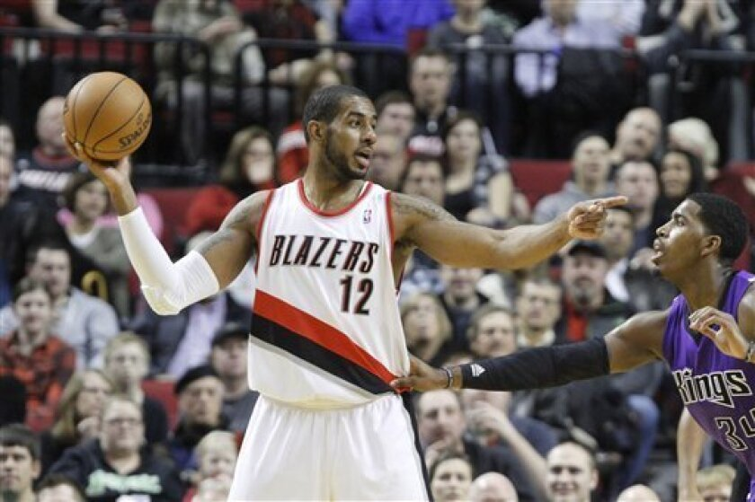 Portland Trail Blazers forward LaMarcus Aldridge, left, points to other players as Sacramento Kings forward Jason Thompson defends during the first quarter of their NBA basketball game in Portland, Ore., Saturday, Dec. 8, 2012.(AP Photo/Don Ryan)